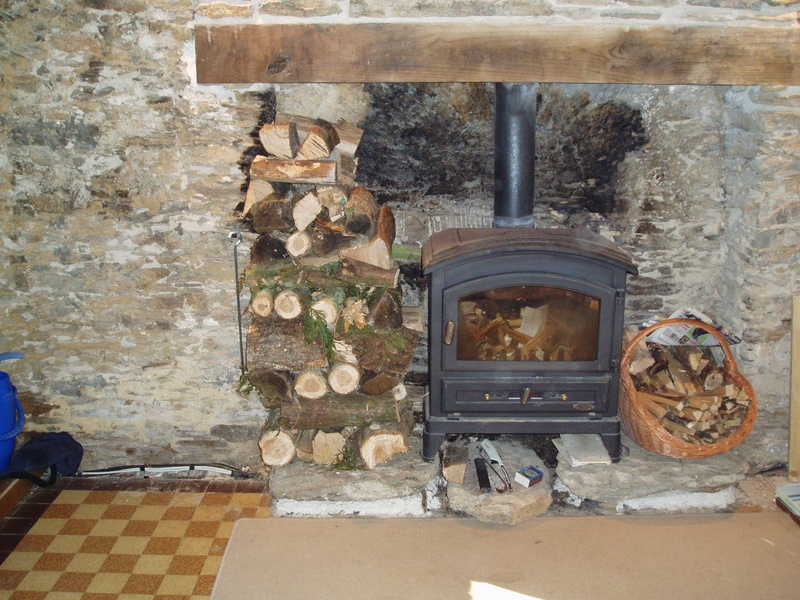 Wood burner in and wall built up